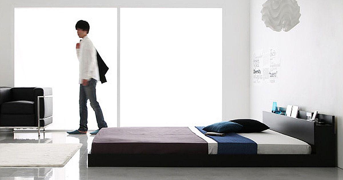 ワンルームで暮らす男とベッド